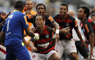 Flamengo's Ronaldinho celebrates after beating Botafogo in their Guanabara Cup semi-final soccer match in Rio de Janeiro