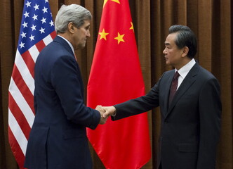 Chinese Foreign Minister Wang Yi and US Secretary of State John Kerry shake hands prior to meetings at the Ministry of Foreign Affairs in Beijing
