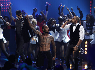 Swizz Beatz, Chris Brown and Ludacris perform at the 40th American Music Awards in Los Angeles