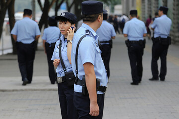Policemen secure the area near the court in Beijing
