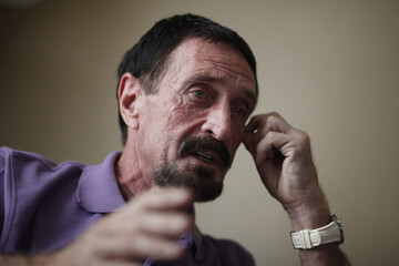 John McAfee, anti-virus software guru, speaks during an interview with Reuters in Guatemala City