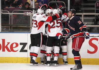 Rangers' Gaborik skates past members of the Senators as they celebrate their second goal during their NHL hockey game at Madison Square Garden