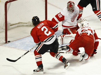 Chicago Blackhawks' Keith  watches a goal scored by teammate Bolland on Detroit Red Wings' goalie Ty Conklin in Chicago
