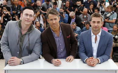 "Cast members Kevin Durand, Ryan Reynolds and Scott Speedman pose during a photocall for the film ""Captives"" in competition at the 67th Cannes Film Festival in Cannes"