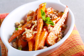 Orange and maple glazed young carrots