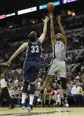 Spurs' Duncan shoots over Grizzlies' Gasol during the second quarter Game 2 of their NBA Western Conference final playoff basketball series in San Antonio