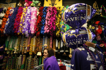Super Bowl beads and Baltimore Ravens balloons are seen for sale at a stall in the French Quarter of New Orleans