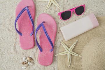 Sandal and beach item on sand