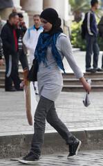 Alwoman wearing a hijab walks in Algiers