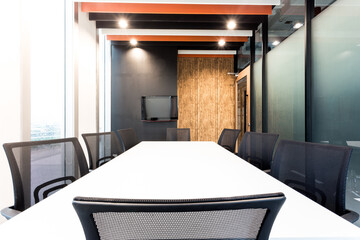 Modern meeting room with wooden walls and large windows