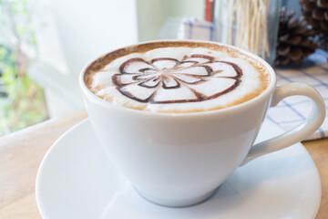 hot coffee with foam milk art in afternoon break