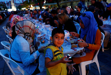 People break their fast at Sultanahmet Square on the first day of the holy fasting month of Ramadan in Istanbul
