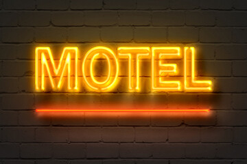 Motel, neon sign on brick wall