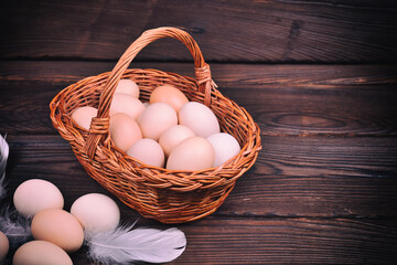 Wicker basket with raw chicken eggs
