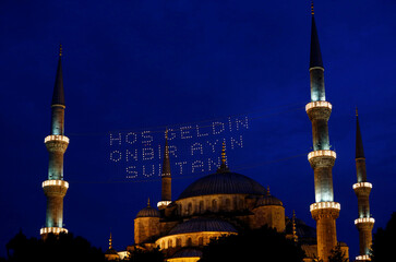 The Ottoman-era Sultanahmet Mosque, also known as the Blue Mosque, is illuminated on the first day of the holy fasting month of Ramadan in Istanbul