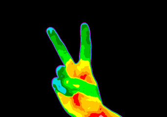 Thermographic image of persons hand showing peace sign with photo showing different temperature in range of colors from blue showing cold to red showing hot which can indicate joint inflammation.