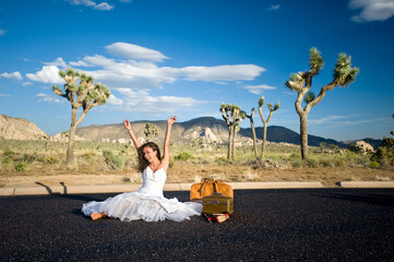Bride celebrating in desert