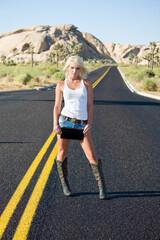 Blond woman standing in street