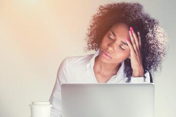 Sleeping African American woman at work