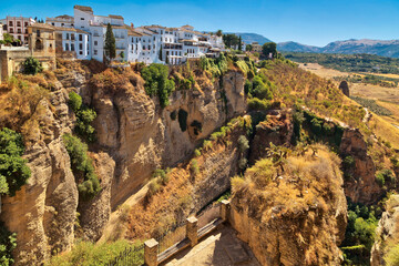 Photo sur Toile Algérie buildings standing on the edge of a cliff in Ronda, Spain