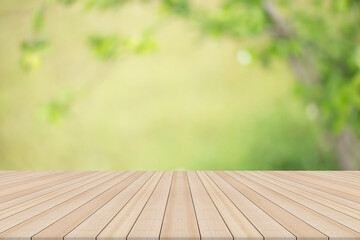 Empty table top on blurred nature background,Space for placing products