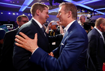 Andrew Scheer is congratulated by runner up Bernier after Scheer won the leadership at the Conservative Party of Canada leadership convention in Toronto