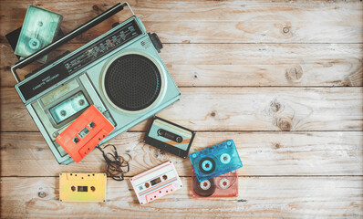 Top view hero header - retro technology of radio cassette recorder music with retro tape cassette on wood table. Vintage color effect styles. Fototapete