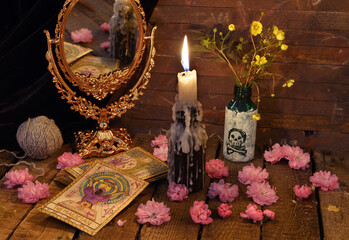 Vintage still life with the tarot cards, flowers and candle