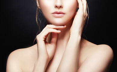 Part of face with lips, neck and shoulder of woman holding hand near cheek. Beauty skin health care style
