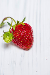 Strawberry on a white wooden background, top viewv