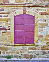 red window, old stone wall house detail