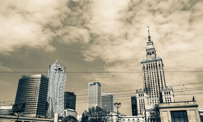 Panorama of Warsaw with modern skyscrapers on a sunny day overlooking the Palace of Culture. Old retro vintage style photo.