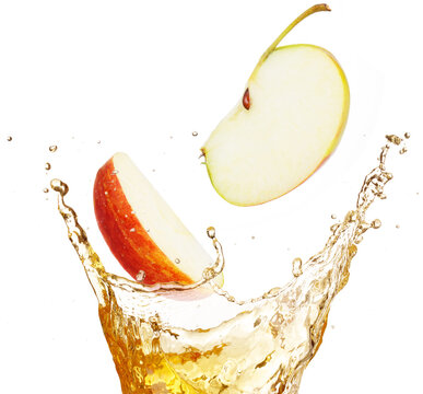 apple slices falling into splashing juice