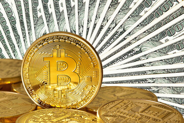 Golden Bitcoins close-up.Dollars currency as a background. Photo (new virtual money ) .Conceptual photo.