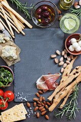 Spoed Fotobehang Voorgerecht Appetizers table concept for mediterranean lunch or dinner. Overhead view. Copy space