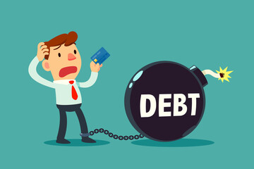 businessman holding credit card chained to debt time bomb
