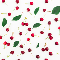 Cherries and leaves on white background. Flat lay. Top view. Colorful pattern