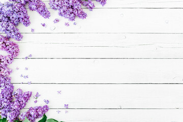 Floral pattern of lilac branches and petals on rustic background. Flat lay, top view. Flower pattern