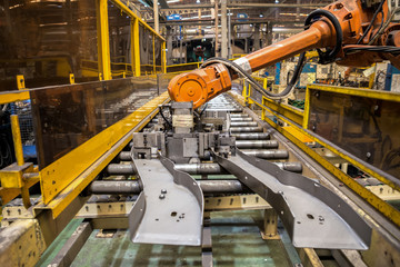 Robot arms handle tool keep automotive part to spot machine