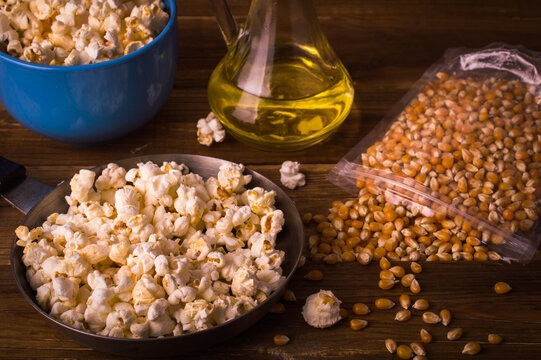 Popcorn on a wooden background. Ingredients