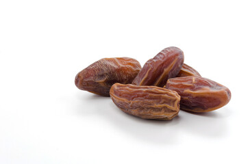 dried date palm fruit isolate on white background, ramadan kareem food