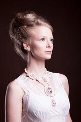 Blonde woman in vintage victorian dress. Rich and vintage. Luxury and elegance. Studio photo