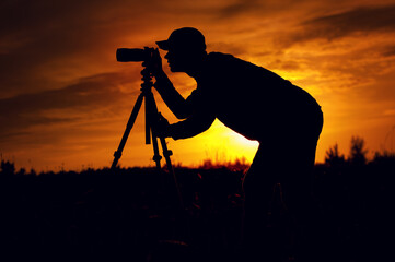 Silhouette of male photographer taking picture