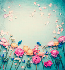 Wall Mural - Floral frame with Lovely flowers and petals, retro pastel toned on vintage turquoise background, top view
