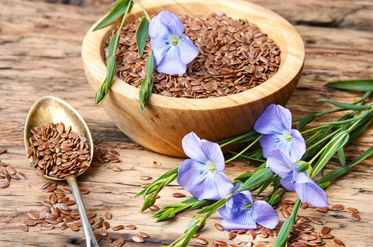 Linseed on wooden background