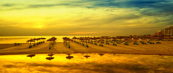 Photo sur Aluminium Jaune Panoramic image of sunrise on the beach in Mallorca. Europe. Spain
