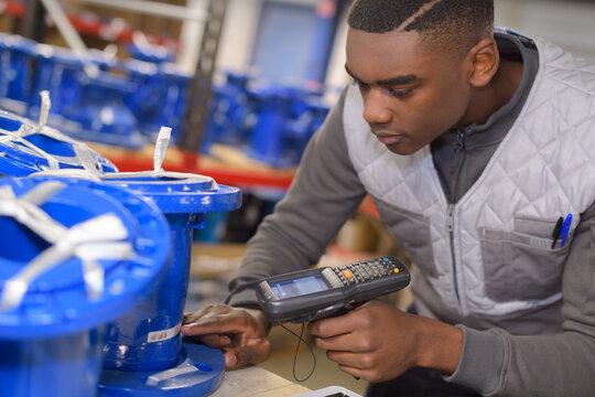 Worker using handheld scanner
