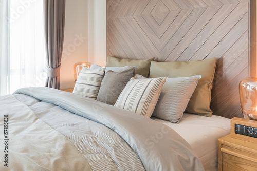 Set Of Pillows On Bed With Wooden Wall Decoration In Classic Style Magnificent Style Bedroom Designs Set Property