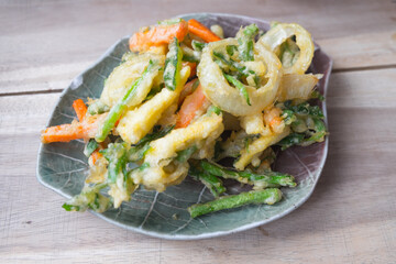 Fried mix vegetables on plate : carrot, onion, long bean