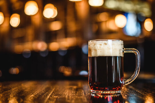 A glass of dark beer on counter